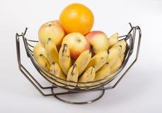 Fruit in a metal basket of fruit  . Royalty Free Stock Photo