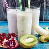 Fruit milkshakes in a transparent glass. Top side view stock images
