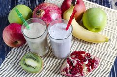 Fruit milkshakes in a transparent glass. Top side view stock photography