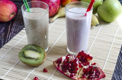 Fruit milkshakes in a transparent glass. Top side view royalty free stock photo