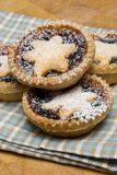 Fruit mince tarts for christmas day on tea towel Royalty Free Stock Image