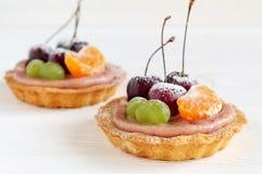 Fruit mini tartlets on white background Stock Image