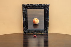 Fruit in the mirror. Looking at the past. Pepper on a table stock photography