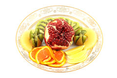 Fruit mix. Assorted fruit on a plate for dessert Royalty Free Stock Images