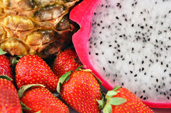 Fruit mix. Yummy healthy fruit mix: pineapple, straberriese and pitaya- dragon fruit Royalty Free Stock Photography