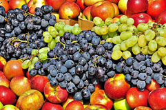 Fruit mix. Autumn fruits at the market: grapes and apples stock photo