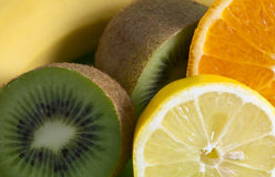 Fruit mix. Mixed tropical fruits on the plate Stock Images