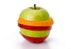 Fruit mix. Sliced fruit ing the shape of an apple Stock Images