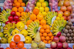 Fruit mix combination stall 2. Fruit mix, combination of different fruits, decoration on market stall, fruits in different colors, apples, plums, avocados, kakis royalty free stock photos