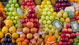 Fruit mix combination stall 3. Fruit mix, combination of different fruits, decoration on market stall, fruits in different colors, apples, plums, avocados, kakis stock photos