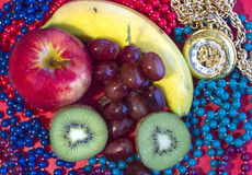 Fruit Mix. Fresh fruit with watch with beads Royalty Free Stock Image