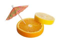 Fruit mix. Orange and lemon with umbrella. On isolated white background royalty free illustration