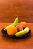 Fruit mix. Plate of ripe fruits on a table Stock Photo