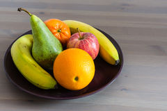 Fruit mix. Plate of ripe fruits on a table Stock Photos