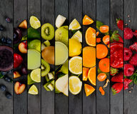 Fruit Mix Stripes. Top view of rainbow colorful mix stripes with fruit, drinks and slices; healthy eating concept stock photo