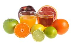 Fruit mix with two glasses filled with juice isolated on white Royalty Free Stock Photos