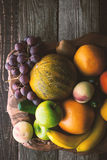 Fruit mix on the wooden bowl top view vertical stock photo