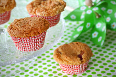 Fruit muffins on a cake stand. And green tablecloth Stock Photo