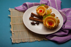Fruit muffins. Cream tartlets with fruits, delicious dessert Royalty Free Stock Images