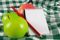 Fruit and note pad Stock Photos