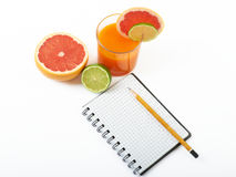 Fruit and a notebook. On a white background Stock Image