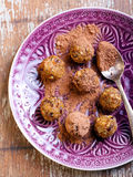 Fruit and nut balls. Dusted in cocoa powder Stock Images