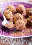 Fruit and nut balls. Dusted in cocoa powder Royalty Free Stock Photos