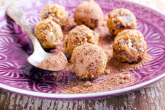 Fruit and nut balls. Dusted in cocoa powder Stock Image