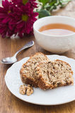 Fruit and nut cake and cup of tea Stock Photos