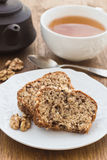 Fruit and nut cake and cup of tea Royalty Free Stock Photos