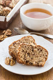 Fruit and nut cake and cup of tea Stock Images