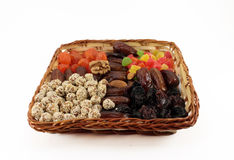 Fruit and nut dessert in a wicker basket. Isolated object on whi Royalty Free Stock Photo
