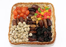 Fruit and nut dessert in a wicker basket. Isolated object on whi Royalty Free Stock Image