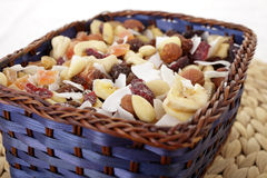 Fruit and Nut mix. Mix of nuts and dried fruit in a wooden basket royalty free stock photos