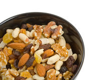 Fruit and Nut Mix. In black serving bowl over white background Royalty Free Stock Photos