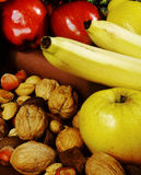 Fruit and nuts. Nuts and fruit close-up Royalty Free Stock Images