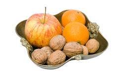 Fruit and nuts in a copper vase Royalty Free Stock Image