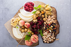 Fruit and nuts snack board Stock Image