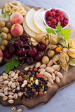 Fruit and nuts snack board Royalty Free Stock Photo