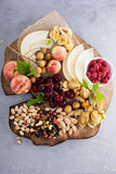 Fruit and nuts snack board Royalty Free Stock Photos