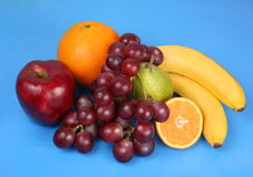 Fruit op een blauw Stock Afbeelding