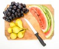 Fruit op een houten raad Royalty-vrije Stock Foto's