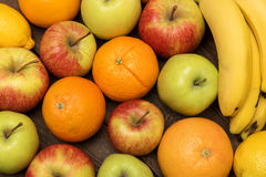 Fruit orange, apples and banana on the wooden boards table stock photos
