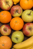 Fruit orange, apples and banana on the wooden boards table royalty free stock photography