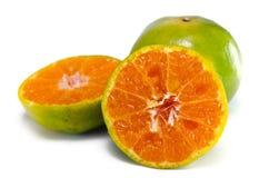 Fruit orange avec la demi vue d'isolement sur le blanc Photos stock