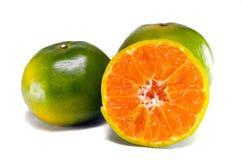 Fruit orange avec la demi vue d'isolement sur le fond blanc Images libres de droits