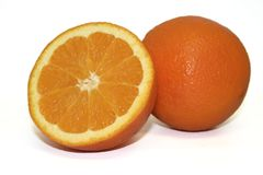 Fruit - Orange Cut. Cut half orange and whole orange sit together Stock Photo