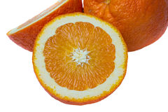 Fruit orange demi et entier d'isolement Photographie stock