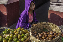 Fruit and orange seller Badung traditional market, Bali - Indonesia. Royalty Free Stock Image