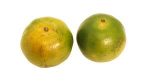 Fruit orange thaïlandais du vert deux avec la feuille verte Photos libres de droits